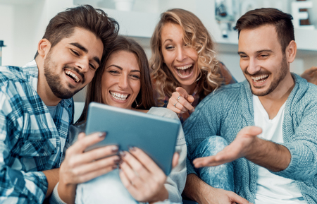 Cheerful group of friends having fun at home,taking selfie. Stock Photo