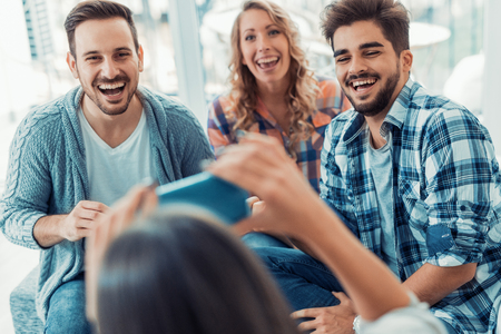 Cheerful group of friends having fun at home. Stock Photo