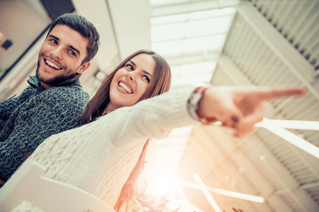 Happy young couple hugging and laughing in the city. Stock Photo