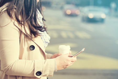Business woman using smart phone in the city.
