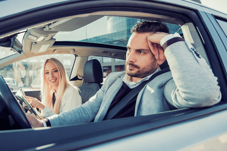 Young couple together in car - man driving.