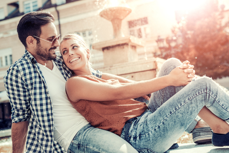 Happy young couple hugging and laughing outdoors. Stockfoto