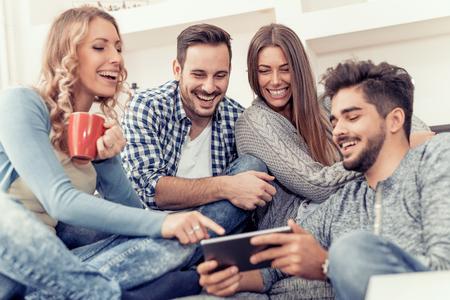 Cheerful group of friends having fun at home,taking selfie. 版權商用圖片