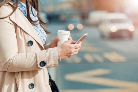 Close up portrait of a successful businessman using a digital tablet outdoors. 版權商用圖片