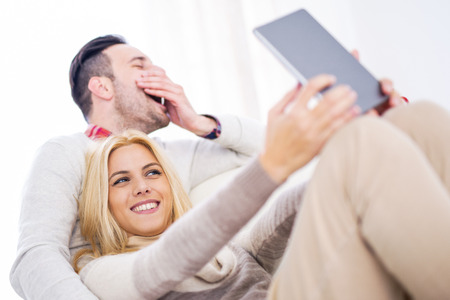 Young couple taking selfie at home.They are enjoying together and having a great time.