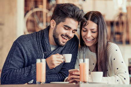Cheerful young couple on a romantic date in a cafe.