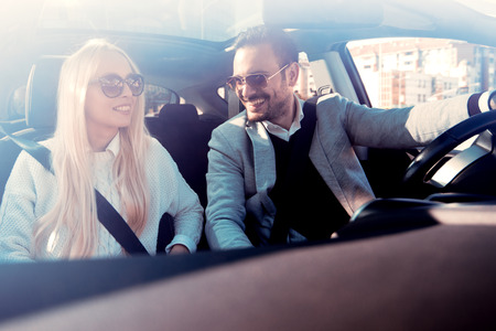 Shot of a young couple on a road trip.They are enjoying in the road trip.