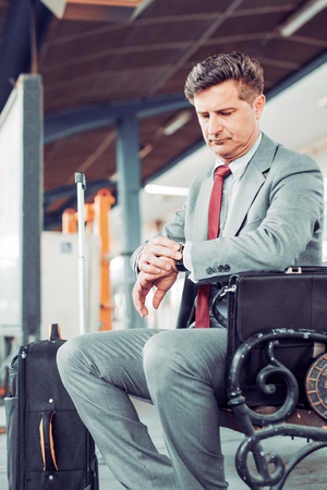 jetsetter: Portrait of a businessman in a train station. Stock Photo