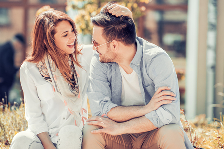 Happy young couple hugging and laughing outdoors. Stock Photo