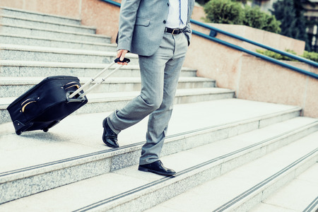 jetsetter: Businessman with luggage on the way to traveling. Stock Photo