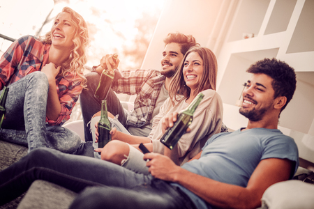 Group of friends having fun at home and enjoying together. Stockfoto