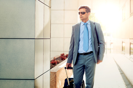 Businessman with luggage on the way to traveling. Stockfoto