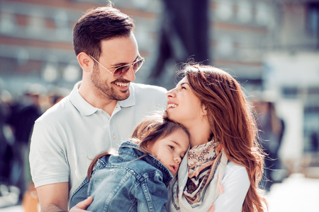 Happy family having fun outdoors and smiling. Stockfoto