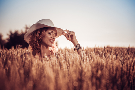 Beautiful woman in the field.Nature,summer holidays,vacation and people concept. Stock Photo