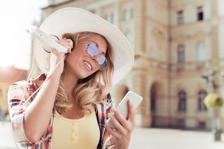 Woman listening to music.People,leisure and technology concept. Banque d'images - 120246786