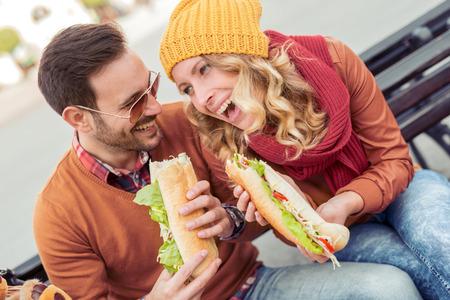 Happy loving couple enjoying breakfast in the city,having fun. Stock Photo