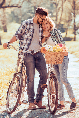 Couple riding their bikes in their free time and having fun on a sunny summer day. Stock Photo
