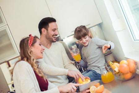 Happy family having breakfast in kitchen.