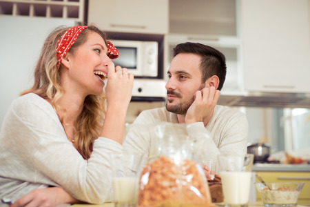 Happy couple enjoying breakfast together at home. Stock Photo