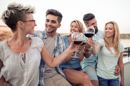 Group of friends having party on the roof.Summer vacation, holidays, travel and people concept.
