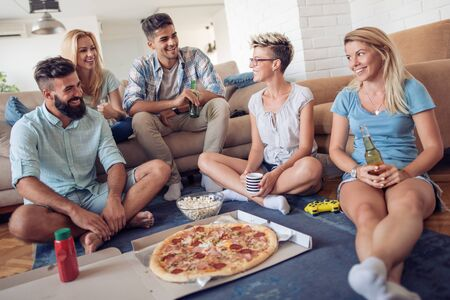 Group of friends sharing pizza together.Fast food,friendship and lifestyle concept.