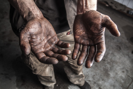 working hands: Dirty hands of mechanic at car station Stock Photo
