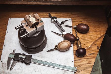 vise: Cross in bullseye vise, gravers and calipers Stock Photo