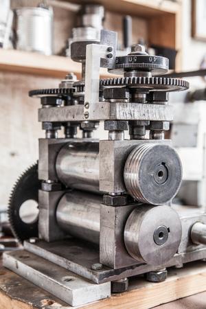 Rolling press tool in jewelers workroom Stock Photo