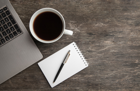 Top view of notebook, notepad, pen and coffee. Business still life on old wooden table Reklamní fotografie