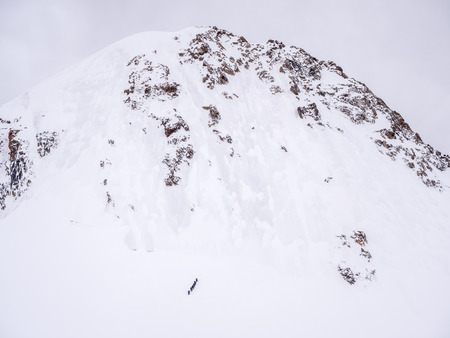Group of climbers on the way to the top of the mountain