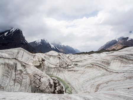 Glacier and river landscape with interesting ice texture and mountains Reklamní fotografie