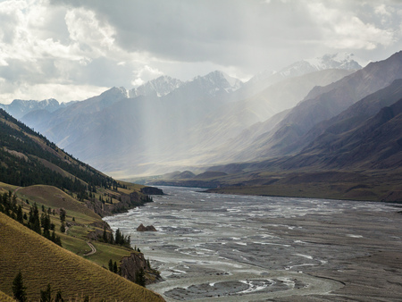 Beautiful rainy landscape with river in mountains