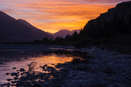 Beautiful sunrise with colorful sky, river and mountains