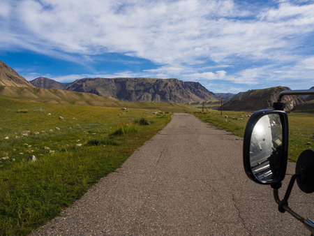 Beautiful landscape with road and rearview mirror Imagens
