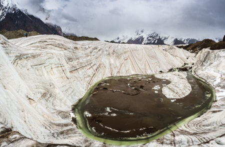 Wide-angle view of the river in the glacier with climbers