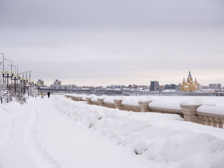 NIZHNY NOVGOROD, RUSSIA - February, 21nd, 2019: Winter view of Cathedral Church and Nizhny Novgorod stadium built for football world cup 2018 in Russia 에디토리얼