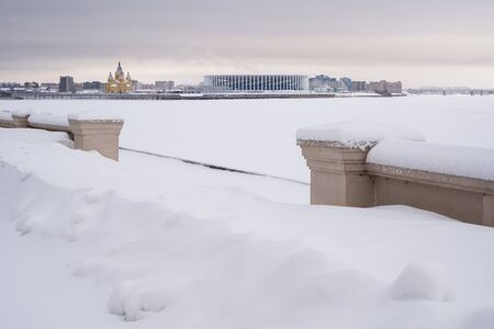 NIZHNY NOVGOROD, RUSSIA - February, 22nd, 2019: Winter view of Cathedral Church and Nizhny Novgorod stadium built for football world cup 2018 in Russia 에디토리얼