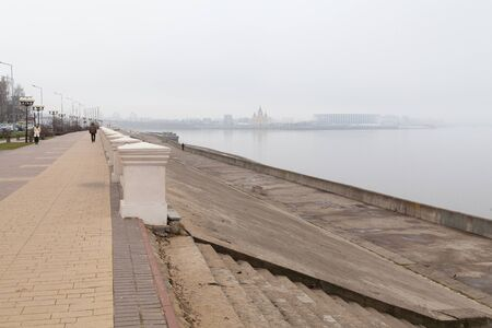NIZHNY NOVGOROD, RUSSIA - April, 11th, 2019: River Volga bank, Cathedral Church and Nizhny Novgorod stadium built for football world cup 2018 in Russia in fog 에디토리얼