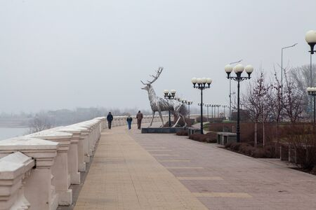 NIZHNY NOVGOROD, RUSSIA - April, 11th, 2019: Volga river bank and steel deer sculpture - symbol of the Nizhny Novgorod