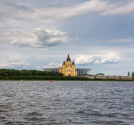 NIZHNY NOVGOROD, RUSSIA - June, 2019: View of Nizhny Novgorod stadium built for football world cup 2018 in Russia and Alexander Nevsky Cathedral from Oka river 에디토리얼
