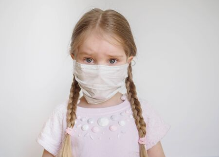 Little girl with two pigtails in medical mask. 스톡 콘텐츠