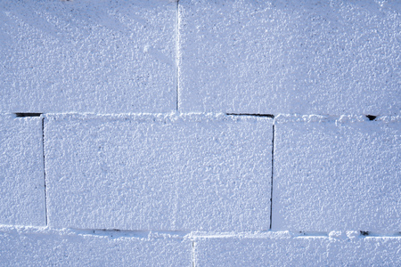 A white brick wall.