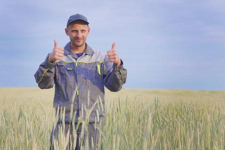 young farmer near a rye field. copy space