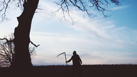 soft focus. Grim Reaper sunset silhouette. concept of death.
