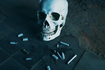 Smoking kills concept, portrait of a smoking skull Stock Photo