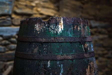 Old rusty barrel in an abandoned warehouse