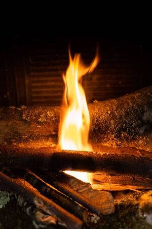 Starting up a fire with wooden sticks inside a chimney