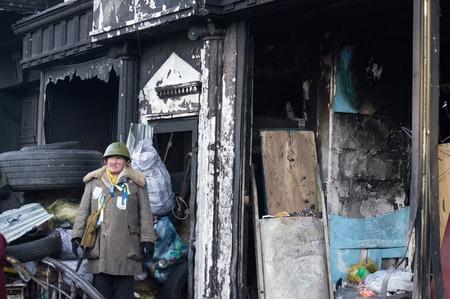 protester: Protester near the burned-out house in the Hrushevskogo street