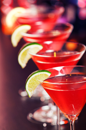 A cosmopolitan, or informally cosmo, is a cocktail made with vodka, triple sec, cranberry juice, and freshly squeezed lime juice or sweetened lime juice.  Фото со стока
