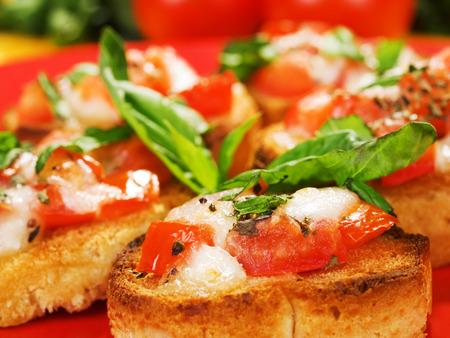 Italian bruschetta with tomato, mozzarella and basil